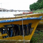 Yellow boat with hole in Cantabria