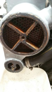 Resealing the end of the heat exchanger. Top cylinder: coolant, small one below: oil